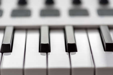 MIDI keyboard with pads and faders. Stock Photo