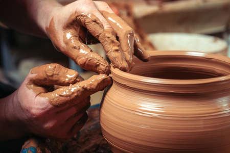 Potter at work. Workshop place