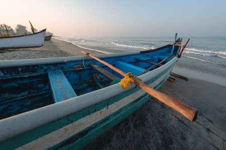 Old fishing boats on beach in Goa, India