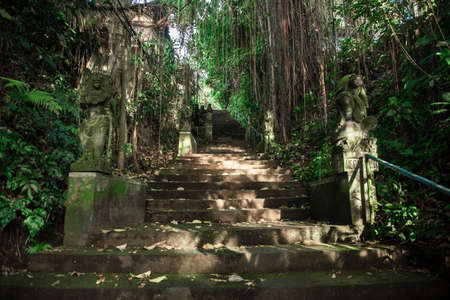 Old concrete sculptures along the stairs. Bali, Indonesia