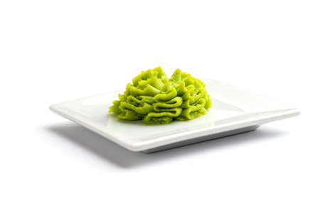 Portion of wasabi in a white gravy boat