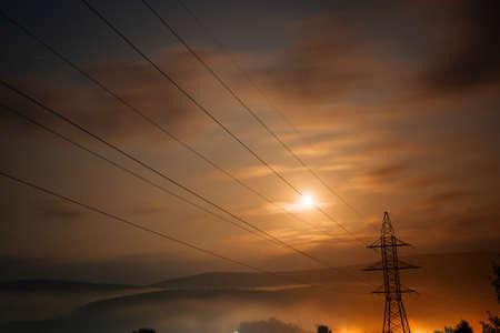 Power line at sunset. Electricity. Stock fotó
