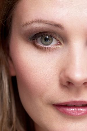 half portrait of a girl face with makeup photo