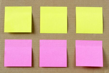 Six colored (yellow and pink) notes on cardboard photo