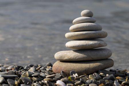 top seven: pebble stack on the sea coast lline Stock Photo