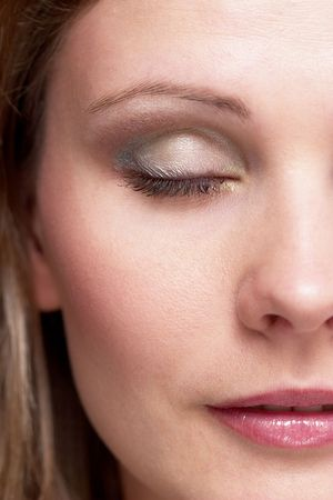 half portrait of a girl face with makeup, one eye close photo