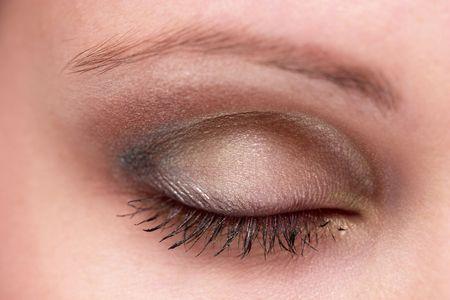 Closed woman eye with makeup. Macro shot. photo