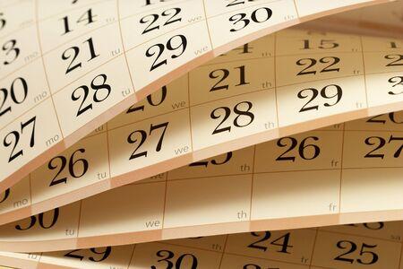 turns of the year: Calendario de fragmentos a medio abrir, las hojas en diferentes �ngulos Foto de archivo