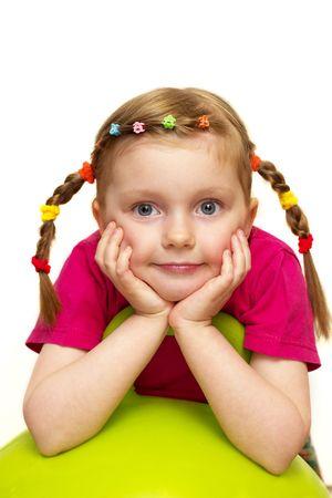 Funny smiling little girl portrait over white background