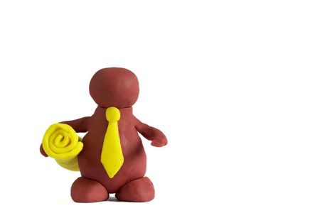 Plasticine man keeping a yellow roll isolated over white background photo