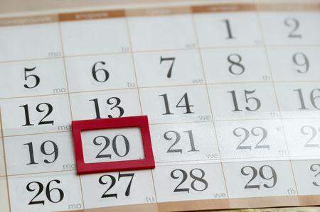 Twentieth Tuesday with red plastic mark frame on calendar macro shoot photo