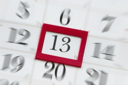 13th: Friday the 13th calendar with red plastic square mark macro shot Stock Photo