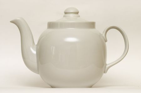 faience: White glazed faience tea pot isolated over grey background Stock Photo