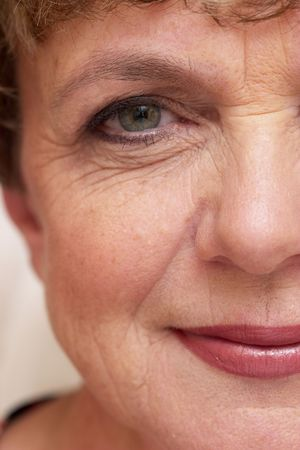 Senior good-looking smiling model with makeup Stock Photo
