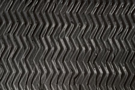 grooved: Black grooved rubber zigzag texture (macro shot)