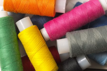 Sewing colored thread mix background (macro shot) photo