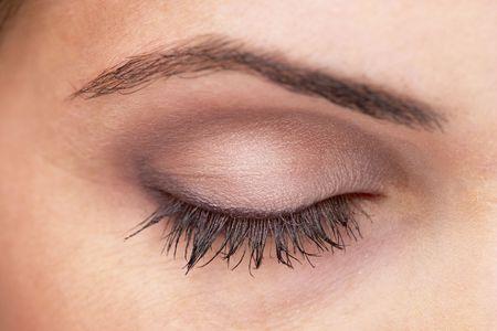 Closed woman eye with makeup. Macro shot.