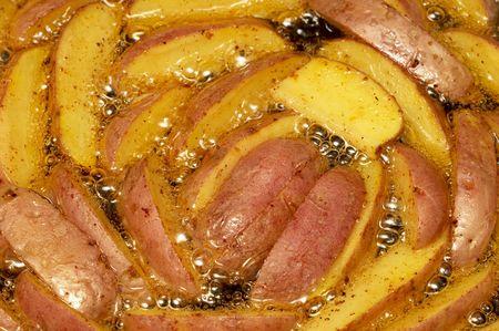 Preparing potato slices in the boiling oil background Stock Photo - 6320053