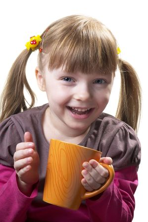 kidding: Funny little girl with tea cup isolated over white background