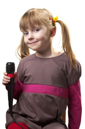 kidding: Funny little girl singing with microphone isolated over white background Stock Photo