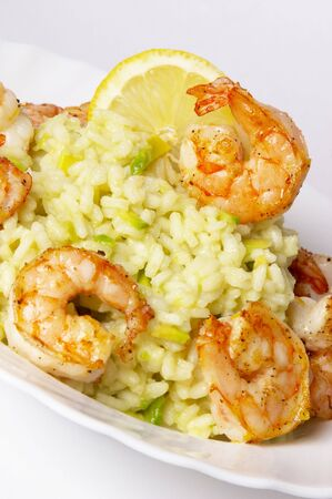 Risotto with fried prawns and avocado macro shot background