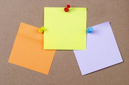 Color sticker notes over cork board background photo