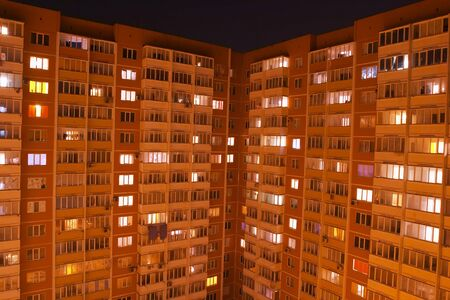 A view to a Russian ghetto house in the night time (background) Stock Photo