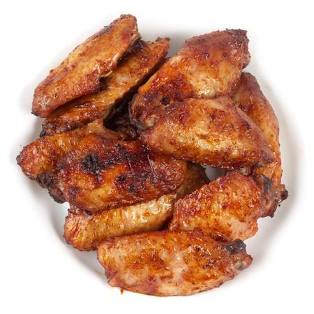 Kurczak Buffalo Wings na makro białej płytce strzału