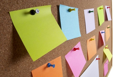 Cork office notice board with blank colorful sticker notes macro shot background Stock Photo - 7271787