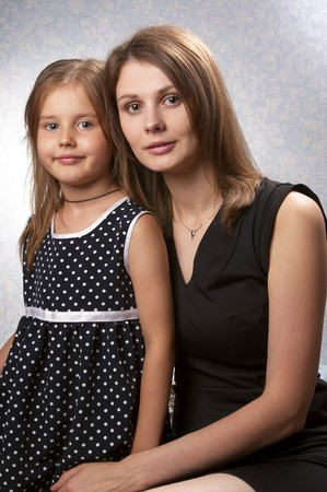 Mother and daughter portrait over light defocused background Stock Photo - 7533064