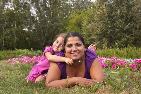 Mother and her little daughter in the city garden photo