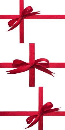 gift tie: Arcos de cinta de celebraci�n de regalo rojo sobre fondo blanco conjunto  Foto de archivo