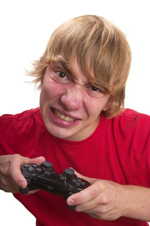 Young angry teenage boy gamer with gamepad in the hands isolated over white background photo