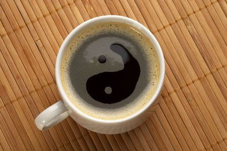 Little white espresso coffee cup on a bamboo mat (upprer view) photo