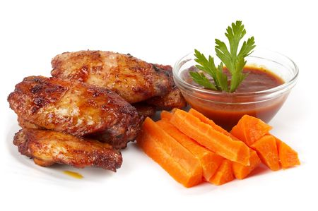 Chicken Buffalo Wings with carrot sticks and hot tomato sauce dip over white background Imagens