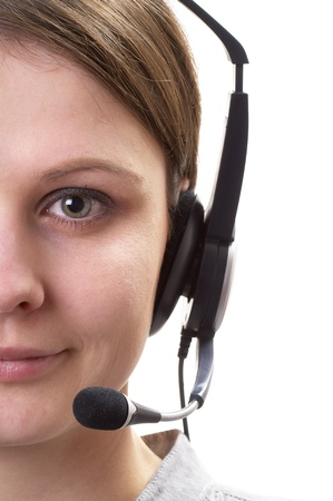 handsfree telephones: Friendly call center operator girl face fragment isolated over white background