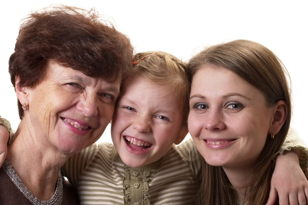mature old generation: Grandmother, daughter and granddaughter portrait isolated over white background