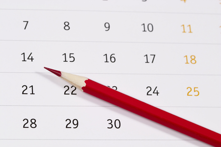 red pencil: Red pencil over slightly defocused calendar background Stock Photo