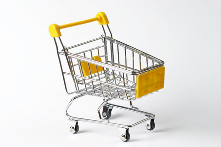 Metallic shopping trolley over white background