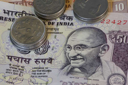 notes and coins of Indian rupees detail with portrait of Gandhi photo