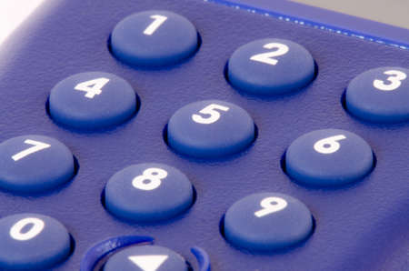 dial pad: close-up of a blue dial pad with numbers