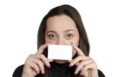 young girl holding a business card in front of her face on white background photo