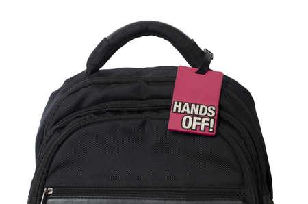 hands off: cerca de una mochila con las manos firmar en �l en el fondo blanco