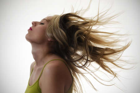 portrait of a woman with hair flying in the air photo