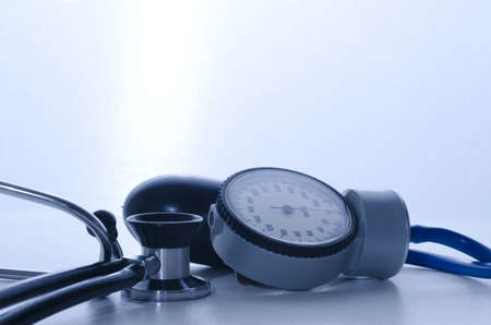 stethoscope and sphygmomanometer medical instruments with blue lights photo