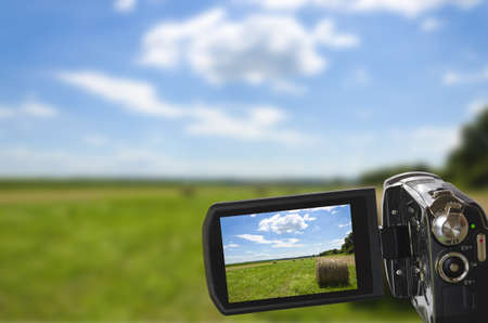 sharp picture of natural landscape seen through digital camcorder and displayed on LCD display