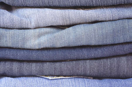 legs folded: close up of a stack of folded jeans horizontally cropped