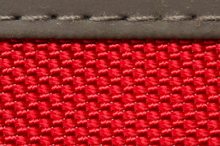 close up of red fabric material detail stitched to another material Stock Photo