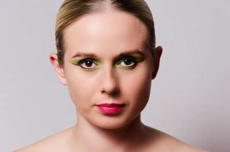 fashion glamor portrait of a blonde woman with heavy makeup horizontally oriented