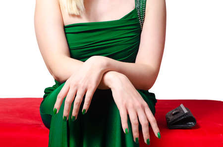 red sofa: all dressed up woman sitting with crossed hands and waiting to go out